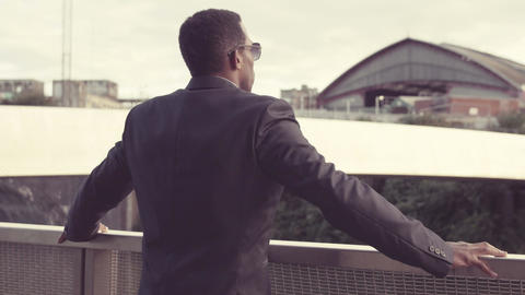 Businessman hoping a good future, looking to the sun Footage