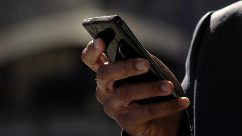 closeup footage on hands of a black businessman using mobile phone, cell phone Footage