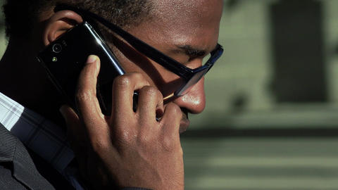 black corporate employer working outdoor with smartphone: overworked man Footage