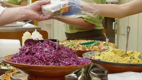 street food: salad, cous cous, humus, falafel, vegetables, meat Live Action
