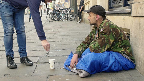 Homeless receive charity in the street Footage