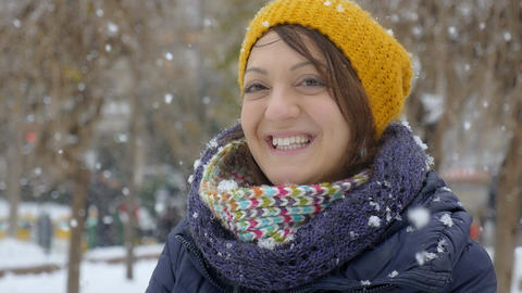smiling happy woman under the snowflakes Footage