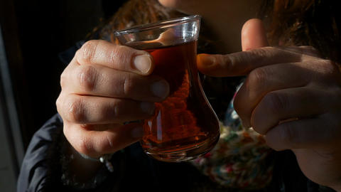 woman holding a glass of traditional turkish tea Footage