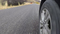 Driving car POV front wheel rural mountain road slow HD 952 Footage