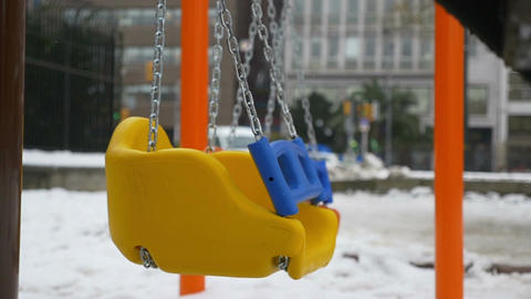 coloured swings in a desert and silent park, chains, child point Footage