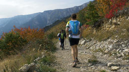 group young runners of skyrunners running autumn mountain trail Footage