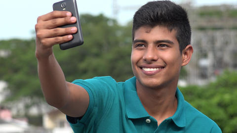 Smiling Teen Boy Taking Selfy Live Action