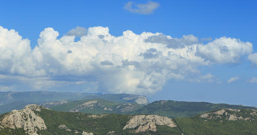 Clouds over the mountains, the south of the Crimea. Zoom. TimeLapse Footage