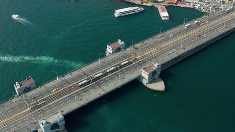 Public Transport Tram Train passing Galata Bridge over Bosphorus in Istanbul Live Action