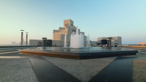 Museum of Islamic Art in Doha Qatar exterior walking in shot showing fountain in foreground Acción en vivo