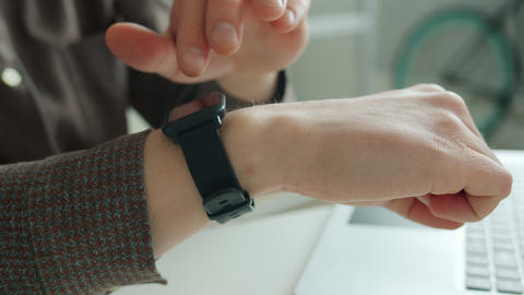 Close-up of businessman's hand touching smart watch screen swiping device Acción en vivo