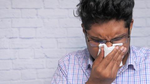 Portrait of sick man sneezes and coughs Live Action