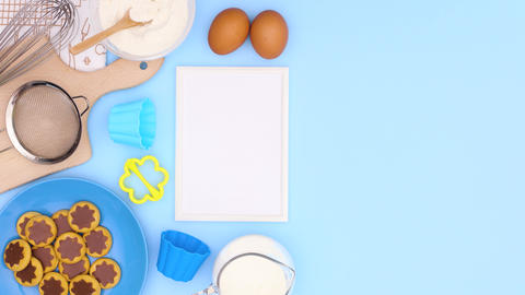 Cookies in blue plate and baking ingredients with frame for recipe on blue theme. Stop motion Animation
