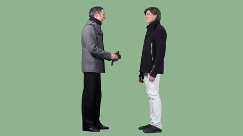 Two men are standing, talking (on transparent background) Footage