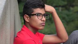 Hispanic Teen Boy Listening Live Action