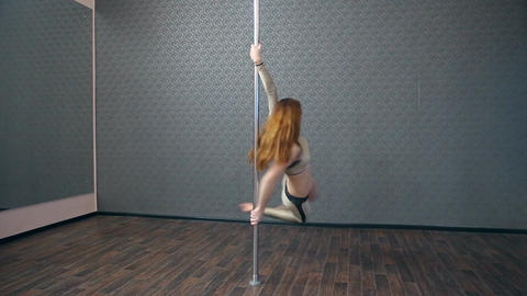 Girl in gold dancing pole dance Footage