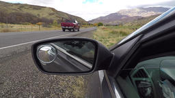 Rear view mirror traffic passing mountain valley POV HD 949 Footage