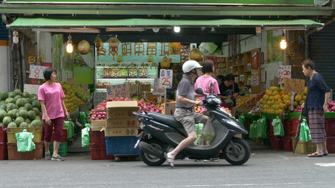 Shoppers at a fruit store in a market Footage