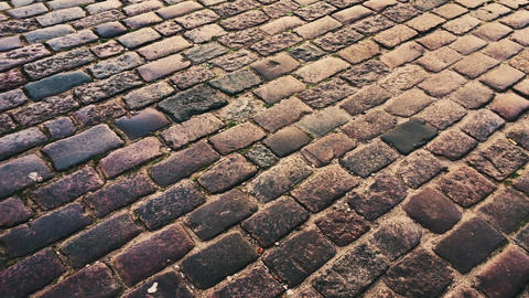 Stone pavement in Old Town, urban details and city transportation Live Action