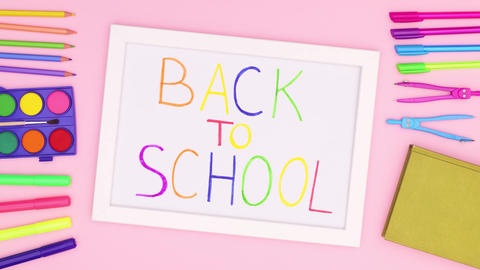 White back to school frame with school stationery on pink theme. Stop motion Animation