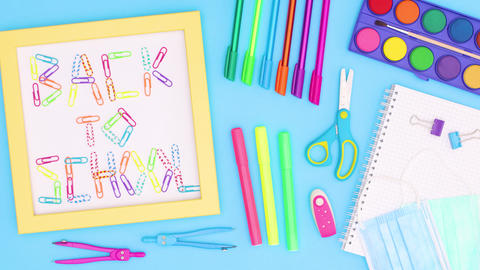 Back to school frame with school stationery on blue theme. Stop motion Animation