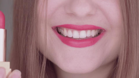 Young woman smiling, pink lipstick and white teeth, macro closeup of a smile Live Action