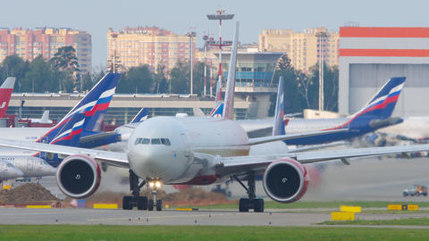 Rossiya Airlines Boeing 777 airliner taxiing to the runway to take off Live Action