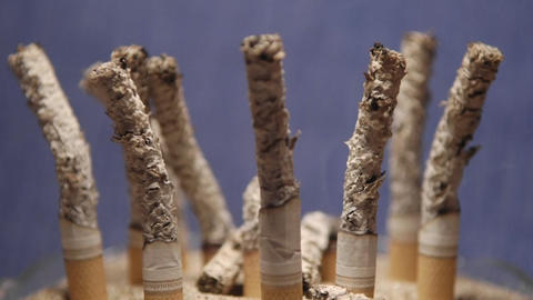 A time lapse of cigarettes burning into ash Stock Video Footage