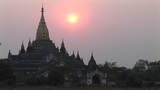 Glowing Pink Sunlight Silhouettes A Tall Asian Temple stock footage