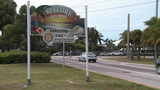 Cars Driving By The Welcome Sign In Key West Florida stock footage