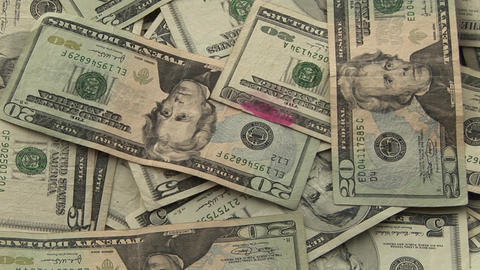 A pile of money sits on a table Stock Video Footage