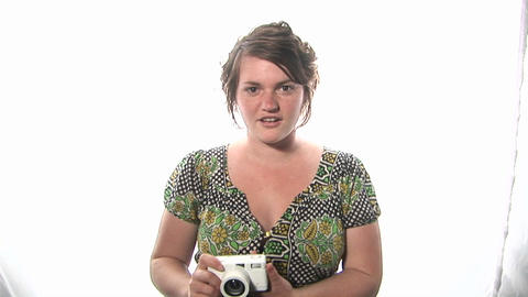 A woman takes a picture with a camera Stock Video Footage