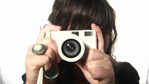 A woman takes a picture with a camera Footage