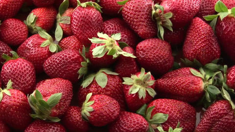 A pile of strawberries sits on a table Footage