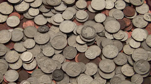 A pile of coins sits on a table Footage