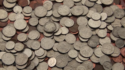 A pile of coins sits on a table Stock Video Footage