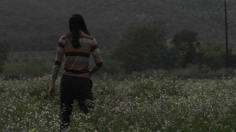 A man acts silly in a field of wildflowers Stock Video Footage