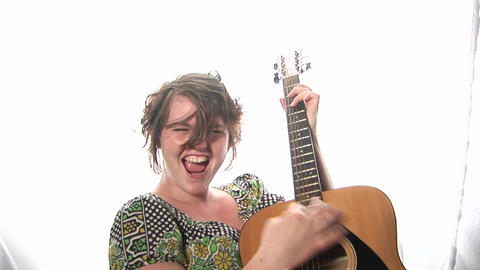 A woman plays guitar Footage