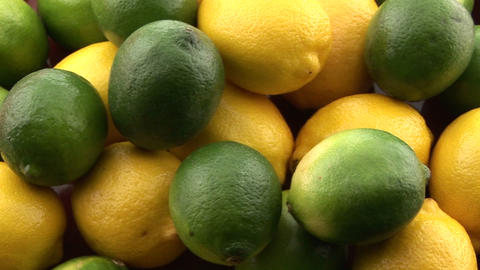 A pile of lemons and limes sits on a table Stock Video Footage