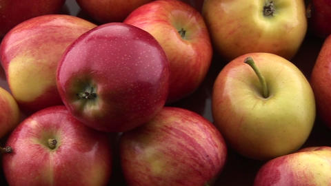 A pile of apples sits on a table Stock Video Footage