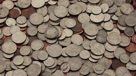 A pile of American coins lies spread out on a surface Stock Video Footage