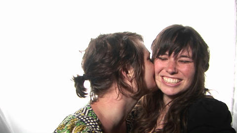 young women happily hug and kiss Stock Video Footage