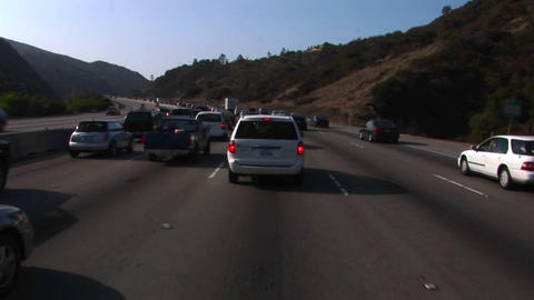 Traffic comes to a stop on a crowded highway Stock Video Footage