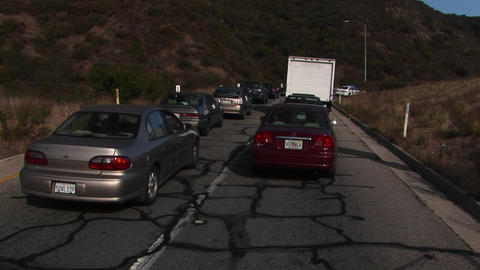 Traffic moves along slowly on a crowded mountain highway Stock Video Footage