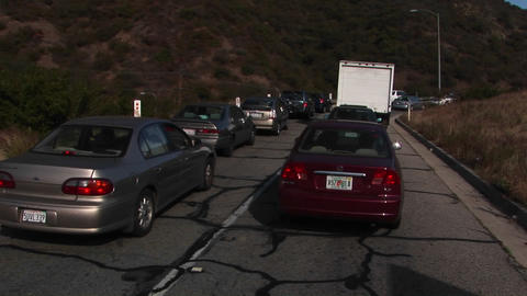 Traffic moves along slowly on a crowded mountain highway Footage