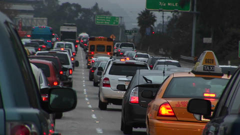 Traffic drives slowly on a crowded highway Stock Video Footage