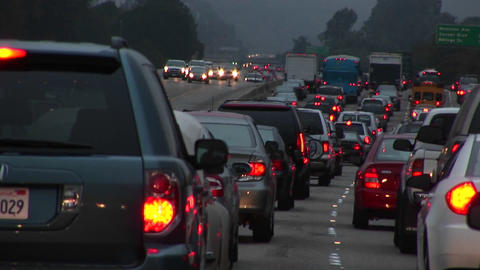 Heavy traffic drives down a freeway Stock Video Footage