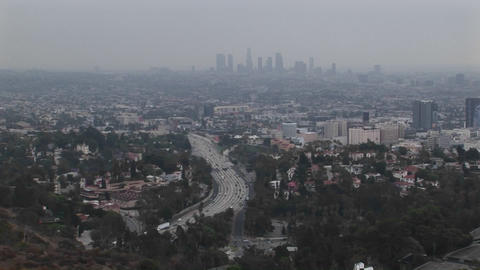 Smog hangs on the distant cityscape Live Action