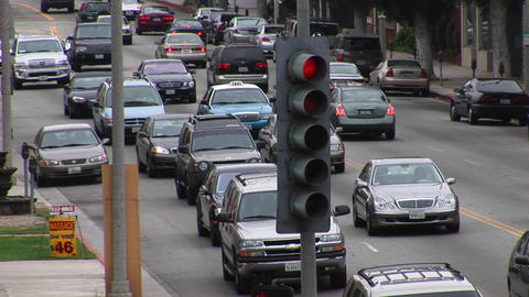 Congested traffic slowly moves along on a city street Stock Video Footage