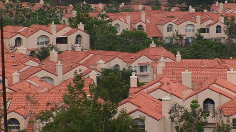 Identical stucco homes occupy a large neighborhood Footage